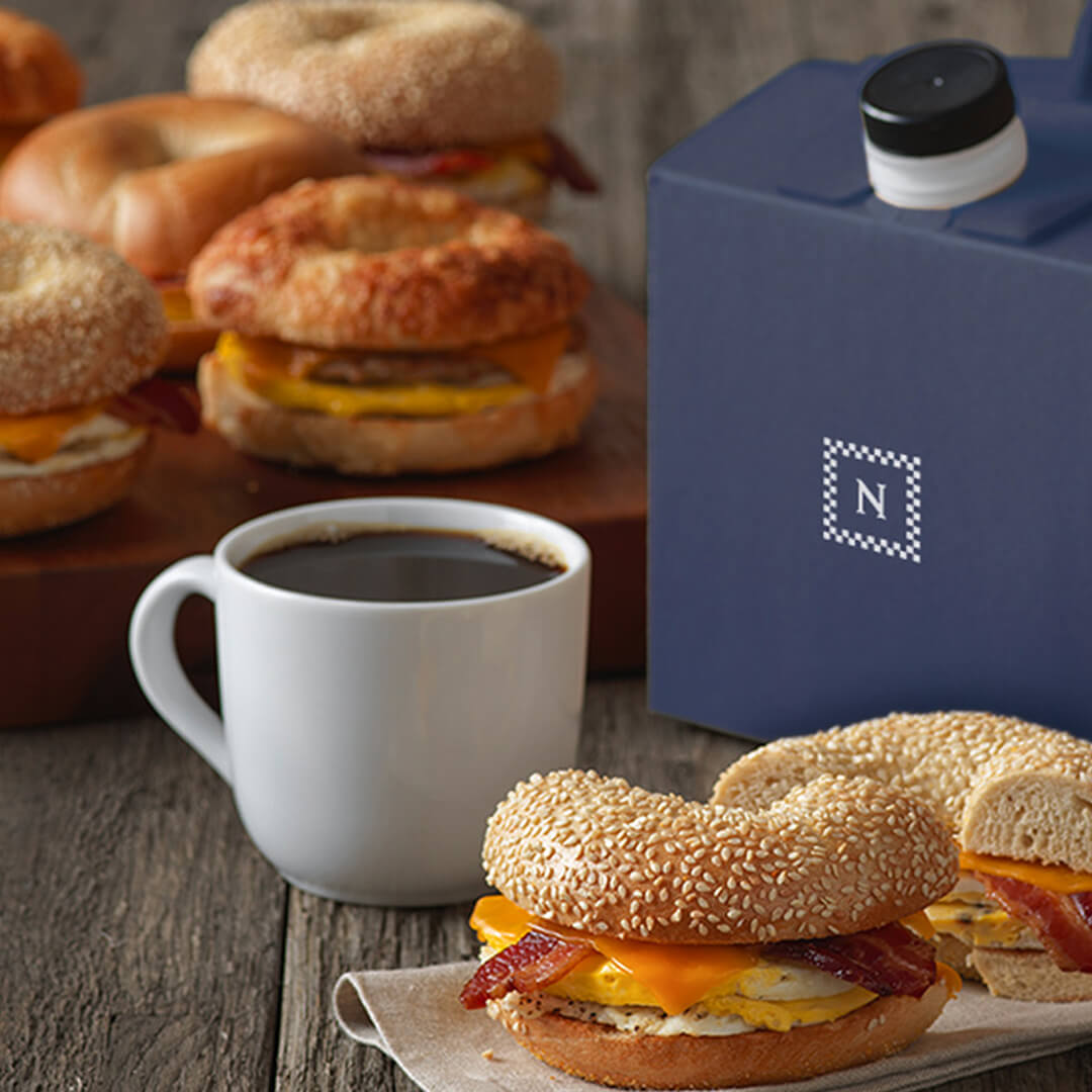 image of a breakfast bagel sandwich and hot coffee from Noah's NY Bagels