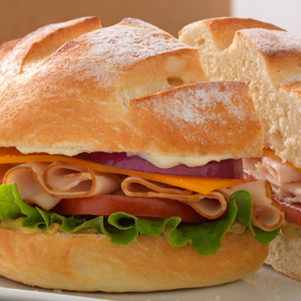 image of an individual lunch sandwich with chips from Noah's NY Bagels
